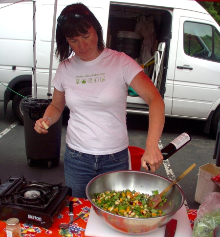 Chef Sara Moot of Persimmon dressing her savory fruit salad on July 8th. Photo copyright 2009 by Zachary D. Lyons.