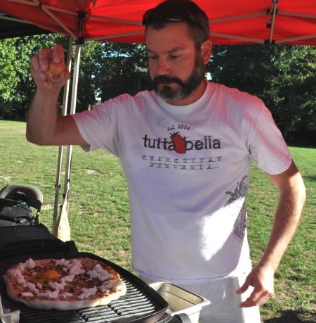 Chef Brian Gojdics from Tutta Bella performing a cooking demonstrationat Wallingford Farmers Market. Copyright Zachary D. Lyons.