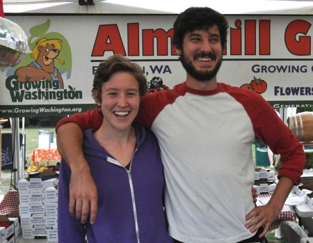 Maggie (left) and Jacob from Growing Washington at Alm Hill Gardens at Wallingford Farmers Market. Copyright Zachary D. Lyons.