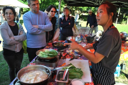 Chef Rachel Yang of Joule, Revel & Trove performing a cooking demonstration on the  final day of the 2013 season at Wallingford Farmers Market. Copyright Zachary D. Lyons.