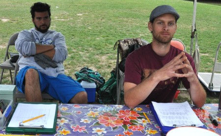 Sergio (left) and Ben at the Market Information Desk at Wallingford Farmers Market. Copyright Zachary D. Lyons.