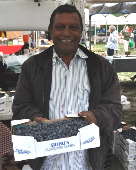 AJ from Sidhu Farms at Wallingford Farmers Market. Copyright Zachary D. Lyons.