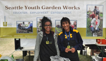 Suez (left) and Shougo from Seattle Tilth Youth Garden Works at Wallingford Farmers Market. Copyright Zachary D. Lyons.
